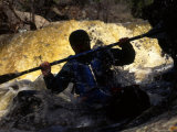 Silhouette of Man Kayaking Through Flooded Canyon Photographic Print by Kate Thompson