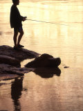 Silhouette of Man Fishing from the Edge of the River, Colorado Fotografisk tryk af Kate Thompson