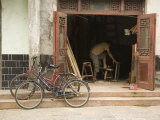 Two Bicycles Parked in Front of Woodworker's Shop, Jingzhou, China Fotografisk tryk af David Evans