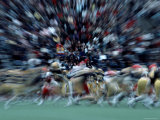 Zoomed View of a Football Game and Crowds in the Stands Photographic Print by Ira Block