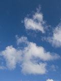 White Puffy Clouds with Blue Sky, Ambergris Caye, Belize Fotografisk trykk av James Forte