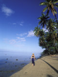 Woman Walking Along Tropical Beach, Hawaii Photographic Print by Rich Reid