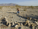 Woman Photographs an Ancient Fish Trap at an Archeology Site Photographic Print by Rich Reid