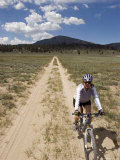 Woman Mountain Biking in the Inyo National Forest Photographic Print by Rich Reid