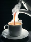 Coffee Being Poured into a Cup Photographic Print by Jürgen Klemme