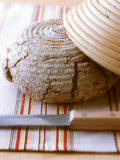 Wholewheat Bread with Round Bread Tin and Knife Photographic Print by J&#246;rn Rynio