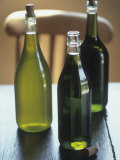 Three Different Olive Oils on Wooden Table Photographic Print by Jean Cazals