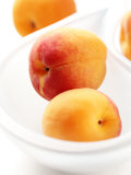 Apricots in a White Bowl Photographic Print by Joff Lee