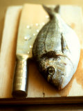 Gilthead Bream on a Wooden Board with Cleaver Photographic Print by Michael Paul