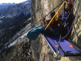 Woman Hanging Out on Her Bivouac Ledge after a Day of Climbing Photographic Print by Kate Thompson