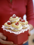 Profiteroles with Raspberry Cream on Gift Box Photographic Print by Susie M. Eising