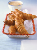 Croissants in Bread Basket, Bowl of White Coffee Behind Photographic Print by J&#246;rn Rynio