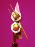 Two Maki-Sushi with Avocado and Salmon on Knife Photographic Print by Hartmut Kiefer