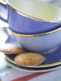 Empty Coffee Cups and Two Biscuits Fotografie-Druck von Frederic Vasseur