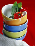 Pile of Soup Bowls with Tomato, Bay Leaf and Chilis Photographic Print by Karl Newedel