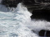 Waves Crash Up Onto Cliff Edges at the Blow Hole on Oahu Island, Hawaii Photographic Print by Stacy Gold