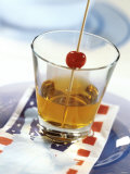 Manhattan in Whisky Glass, Cocktail Cherry on Cocktail Stick Photographic Print by Michael Brauner