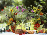 Summery Floral Decoration with Vine Tomatoes Photographic Print by Roland Krieg