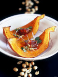 Baked Pumpkin Wedges with Peanut and Garlic Dressing Photographic Print by Jean Cazals
