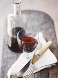 Still Life with Red Wine Glass, Wine Carafe, Napkin and Cutlery Photographic Print by Jean Cazals