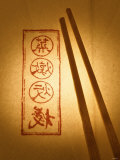 Wooden Chopsticks on Paper with Asian Characters Fotografie-Druck von Misha Vetter