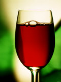 Red Wine in Glass Photographic Print by Vladimir Shulevsky