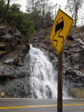 Waterfall Behind Road Sign, California Photographic Print by James Forte