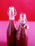 Strawberry Pulp in Flip-top Bottles Photographic Print by Michael Boyny