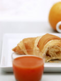 Croissant and Carrot Juice Photographic Print by Brigitte Sporrer