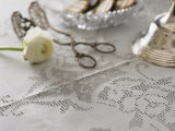 White Hemstitch Tablecloth with Ranunculus and Cake Tongues Photographic Print by Roland Krieg