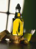 Olive Oil with Slices of Bread Photographic Print by Luzia Ellert