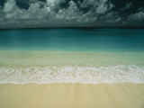 Wave Rolls over a Tranquil Beach in the Marshall Islands Photographic Print by Bill Curtsinger