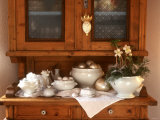 White Crockery with Christmas Decoration on Kitchen Cabinet Photographic Print by Roland Krieg