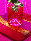 Sprig of Holly in Festive Red Glass on Cushion Photographic Print by Joff Lee