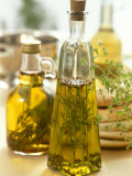 Oil with Herbs and Spices in Two Bottles Photographic Print by Alena Hrbkova