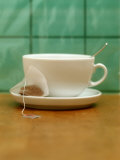 White Teacup and a Tea Bag Photographic Print by Astrid Früh