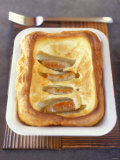 Toad in the Hole (Sausages Baked in Batter, England) Photographic Print by Jean Cazals