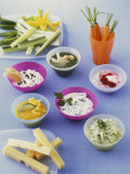 Six Different Dips, Strips of Cheese and Raw Vegetables Photographic Print by Jörn Rynio