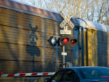 Warning Lights and Gates Save Lives at Train Crossings, Silver Spring, Maryland Photographie par Stephen St. John