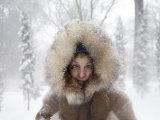 Woman Stands Outside in a Fur-Trimmed Coat after a Snowstorm Fotografisk tryk af Joel Sartore