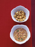 Honey Peanut Sauce and Peanuts in Small Bowls Photographic Print by Peter Medilek
