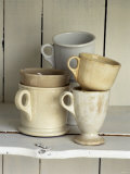 Various Light Coloured Cups on Wooden Shelf Photographie par Ellen Silverman