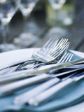 Cutlery and Napkins on a Pile of Plates Photographic Print by Greg Elms