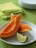 Two Papaya Wedges on a Plate Photographic Print by Michael Paul
