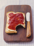 Bread with Butter &amp; Strawberry Jam on Chopping Board Photographic Print