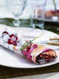 A Place Setting with Printed Fabric Napkin Photographic Print by Wolfgang Kleinschmidt