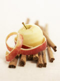 A Peeled Apple on Cinnamon Sticks Photographic Print by Marc O. Finley