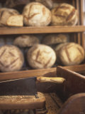 Bread on Shelves at a Baker's Photographic Print by Joerg Lehmann