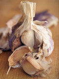A Dried Garlic Bulb Photographic Print by Steven Morris