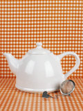 White Teapot and Tea Strainer Photographic Print by Sara Danielsson